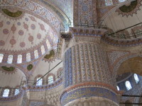 The vast indoor space is covered in cascading painted domes.