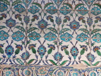 The tiles are made from a fritware body consisting of quartz sand, finely ground glass (the frit) and white clay. Potters did not have access to porcelain at that time.