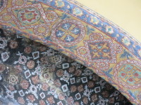 Close up of one of the archways covered in mosaic tile.